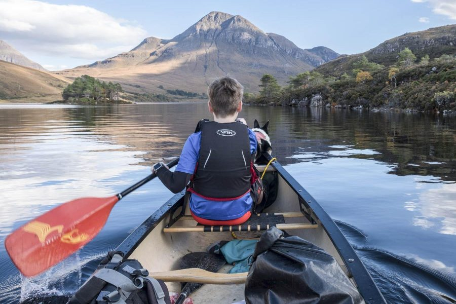 Canadian canoeing on loch, Scotland, with Hamlet Mountaineering