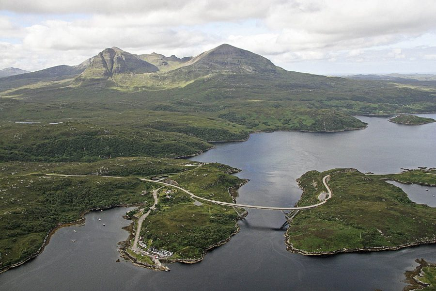 Kylesku Hotel and Kylesku Bridge with Quinag behind